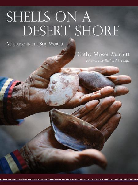 Book cover with two hands showing large emtpy shells